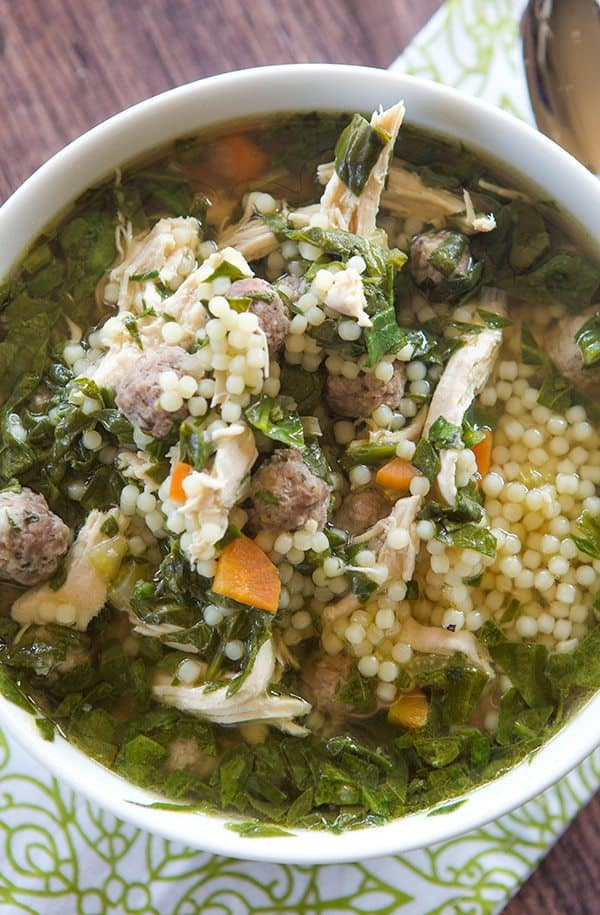 A classic Italian wedding soup recipe, with little bits of pasta, shredded chicken, spinach and of course those little meatballs!