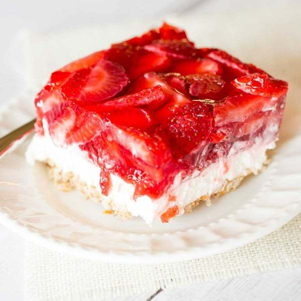 Strawberry Pretzel Salad - The absolutely wonderful nostalgic dessert that showed up at every summer family picnic growing up! | browneyedbaker.com