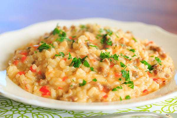Sausage, Pepper & Mushroom Risotto - A hearty meal that needs only Italian bread and a big salad as an accompaniment! | http://www.browneyedbaker.com/italian-sausage-red-pepper-and-mushroom-risotto/