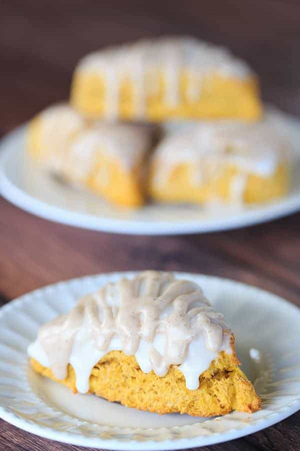 Pumpkin Scones with Spiced Glaze - A Starbucks copycat! | http://www.browneyedbaker.com/pumpkin-scones-spiced-glaze/