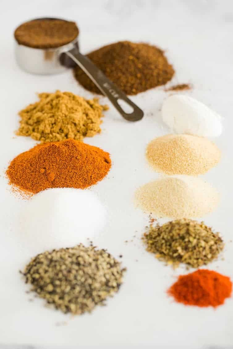 All of the spices lined up and ready to be mixed together for Homemade Taco Seasoning.