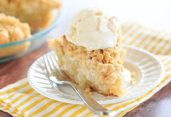 Dutch Apple Pie - A perfect crust piled high with the best apple filling and topped with a crunchy crumb. The perfect fall dessert!   browneyedbaker.com