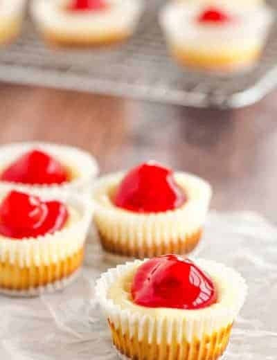These easy mini cheesecakes have been a holiday staple in my family forever! Nilla wafers are topped with cheesecake batter and cherry pie filling. A perfect bite-size treat!