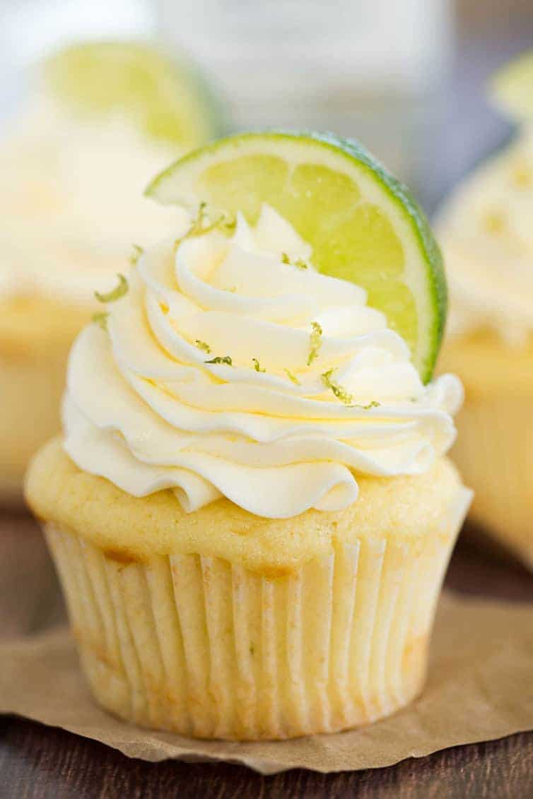 Margarita Cupcake - Vanilla cupcake topped with vanilla frosting, sprinkled with lime zest and topped with lime wedge.