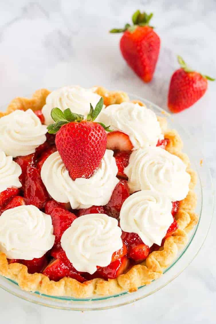 Strawberry Pie - This fresh strawberry pie is 100% homemade from my favorite crust, a delicious glaze, and sweet whipped cream. A perfect summer dessert!