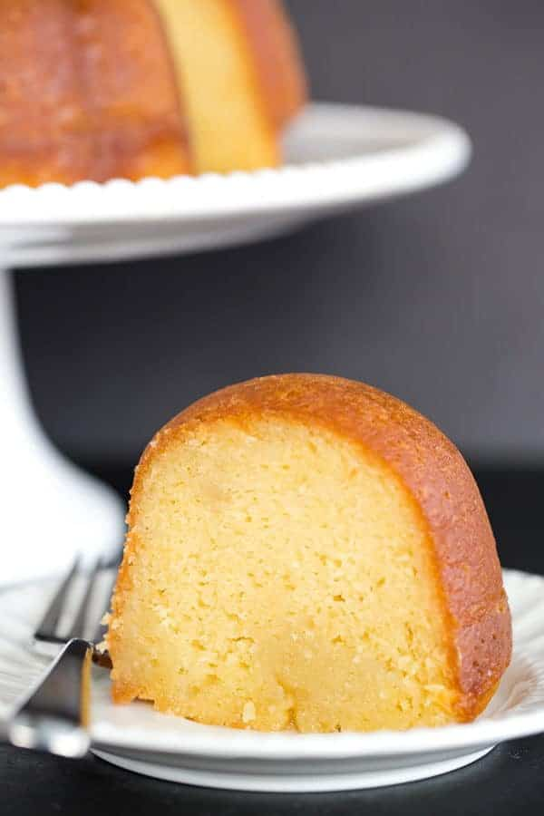 This rum cake is made completely from scratch, has the most tender, moist crumb, and is drenched in rum flavor without being overpowering. Perfection!