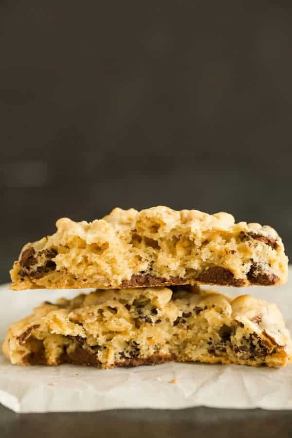 A thick and chewy oatmeal chocolate chip cookie broken in half.