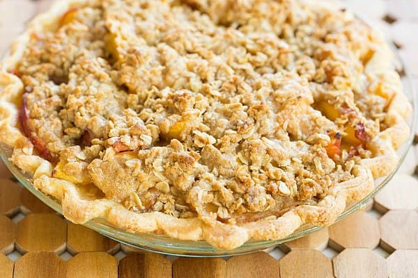 Peach Crumble Pie Recipe on @browneyedbaker :: www.browneyedbaker.com