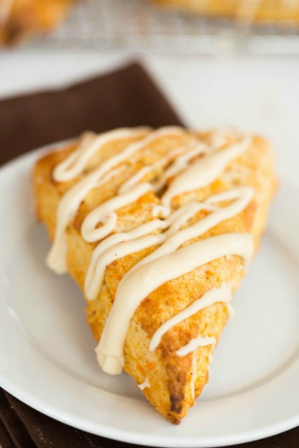 Sweet Potato Scones with Maple Cream Glaze by @browneyedbaker :: www.browneyedbaker.com