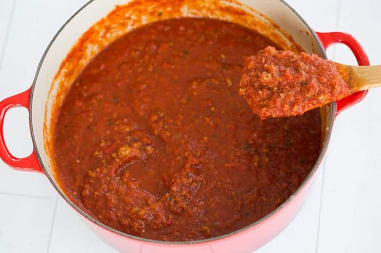 This homemade meat sauce is the BEST! It's thick, hearty, and uses a combination of beef, pork and veal for phenomenal flavor.