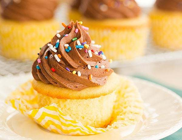 Vanilla Cupcakes with Chocolate Buttercream Frosting - The perfect cupcake for birthdays! | browneyedbaker.com