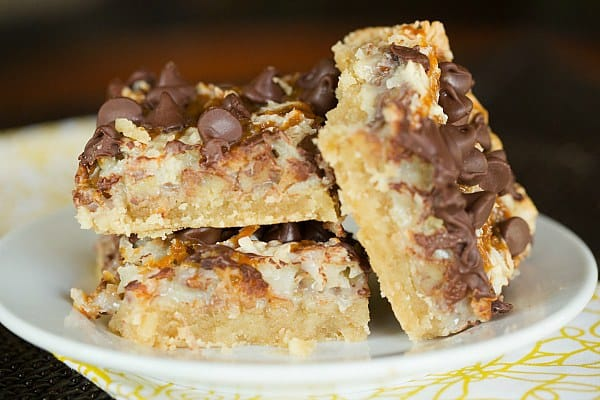 Ultimate Magic Bars - A brown sugar shortbread crust, pecans, coconut, chocolate chips and caramel set in sweetened condensed milk. Easy and delicious! | browneyedbaker.com