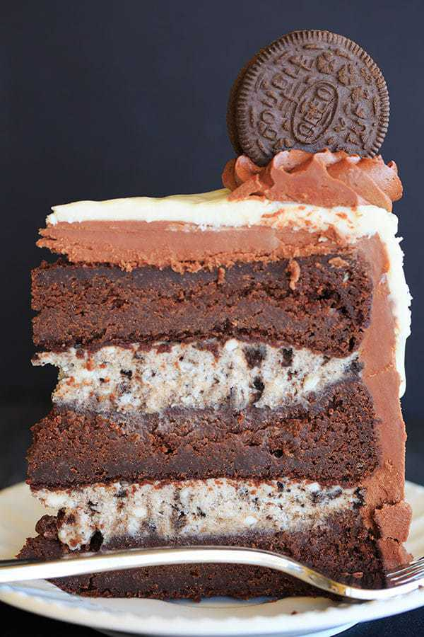 The ULTIMATE Cookies and Cream Oreo Cake - A triple layer chocolate cake with cookies and cream filling, chocolate fudge frosting, white chocolate glaze and more Oreos on top! | http://www.browneyedbaker.com/cookies-and-cream-oreo-cake/
