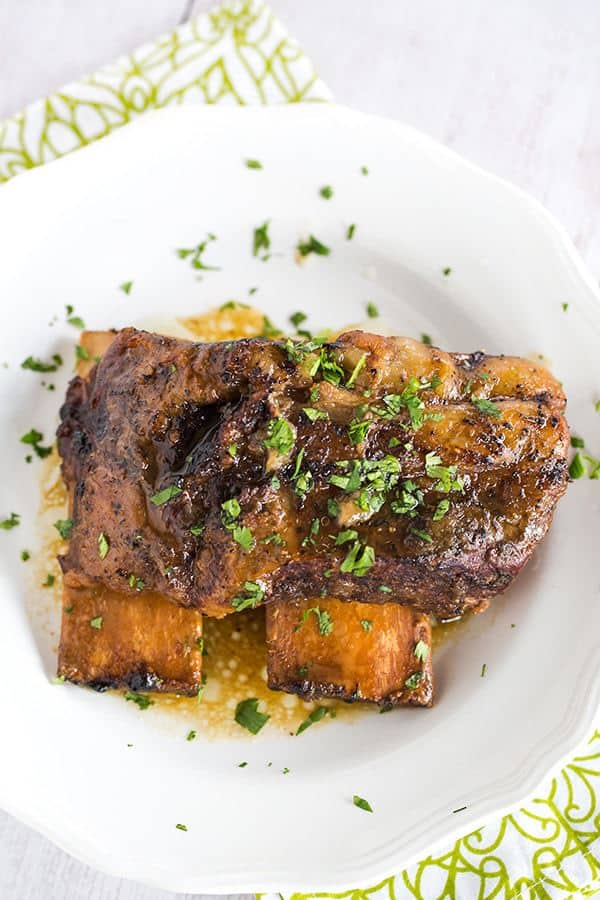 Slow Cooker Korean Short Ribs are an easy, set it and forget it meal that is full of amazing flavor and tender, falling apart meat! | browneyedbaker.com