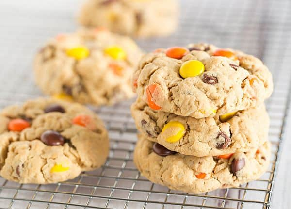 Peanut Butter Lover's Monster Cookies - A peanut butter dough loaded with oats, chocolate chips, peanut butter chips and Reese's Pieces! Go bake these NOW! | browneyedbaker.com