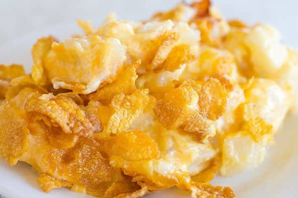 This easy potato casserole is creamy, cheesy and topped with crunchy Corn Flakes.