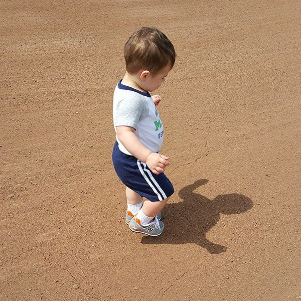 Joseph running around the baseball field