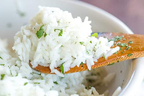 A copycat recipe for Chipotle's popular cilantro-lime rice, with a simple method to ensure light, fluffy rice with no clumps!