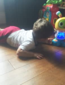 Joseph playing with his dancing robot