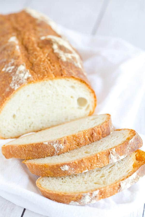 This Italian bread recipe takes some time to come together, but the hard crust and chewy bread are 100% worth it. Totally necessary with a bowl of pasta or a hearty soup!
