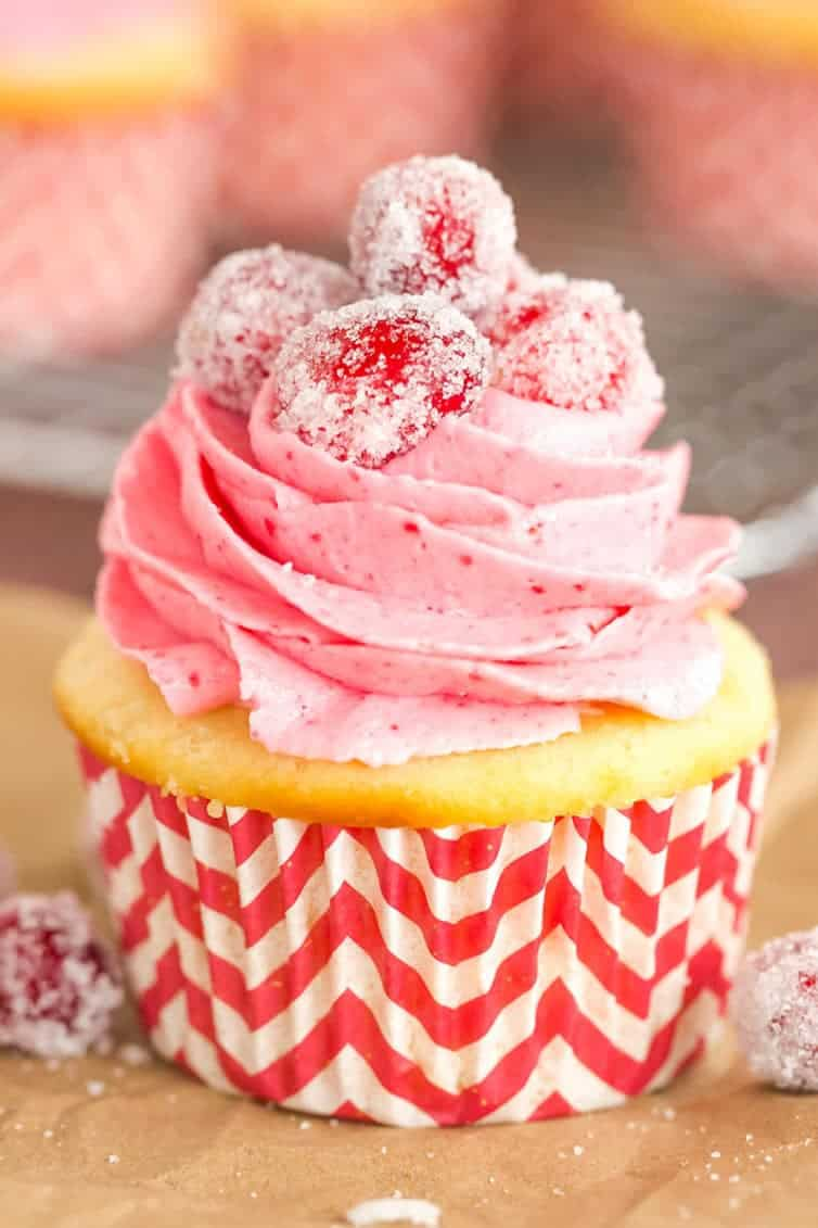 Sparkling Cranberry White Chocolate Cupcakes - Vanilla cupcakes with white chocolate ganache filling and cranberry buttercream frosting. | browneyedbaker.com