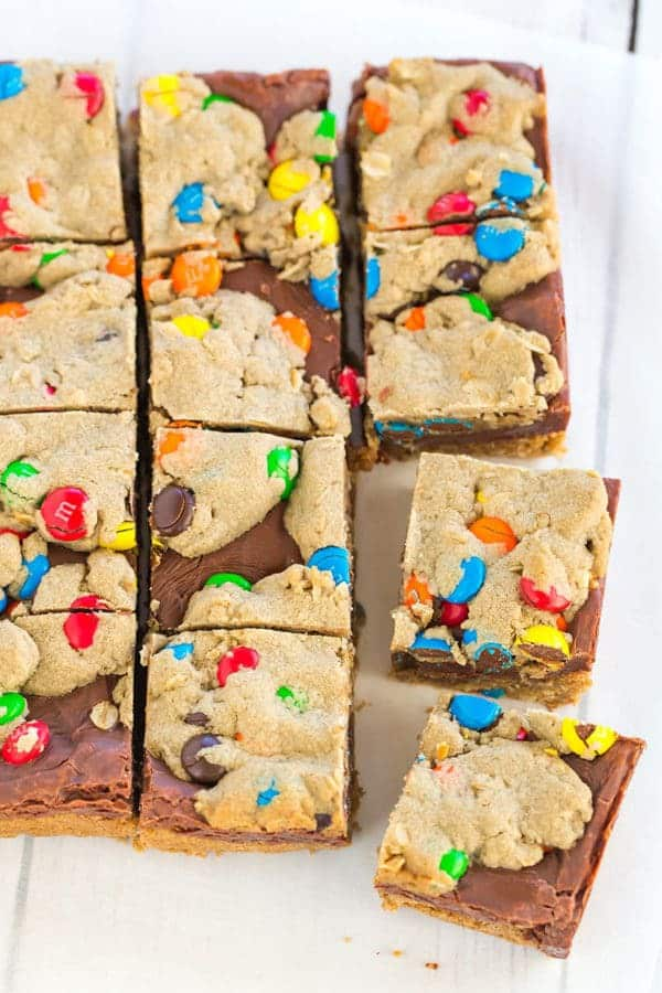 Monster cookie bars with the classic combination of peanut butter, oats, and M&Ms, plus a layer of fudge running through the center!