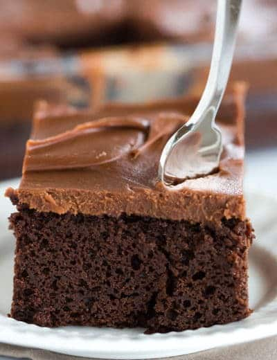 This fabulous chocolate sheet cake only requires one pot for mixing and is topped with the most amazing milk chocolate ganache frosting.