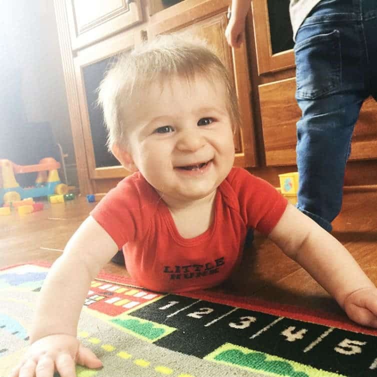 Dominic playing on the floor, trying to crawl!