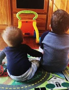 Joseph and Dominic sitting next to each other watching TV