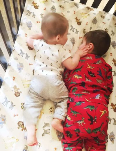 Joseph and Dominic snuggling together