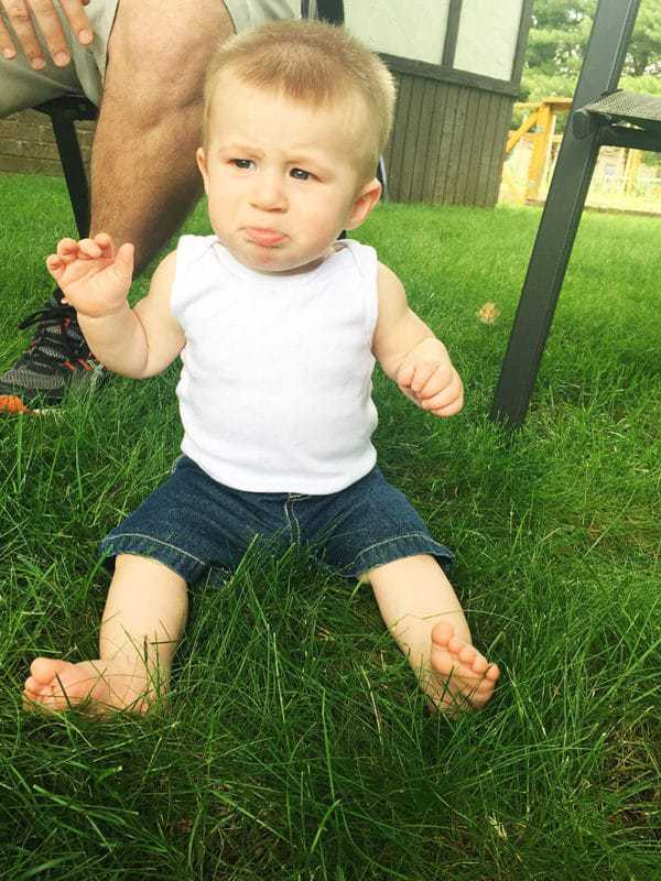 Dominic is not a fan of sitting in the grass