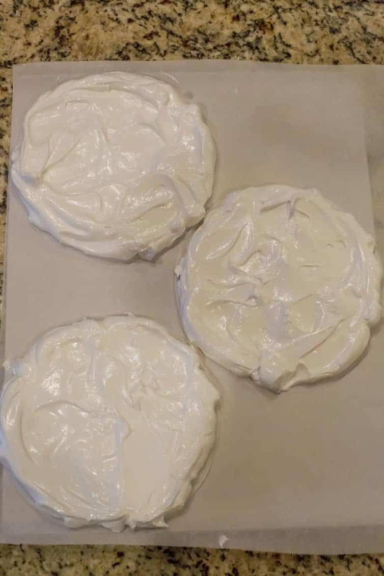 Circles of meringue ready to be baked into pavlova.