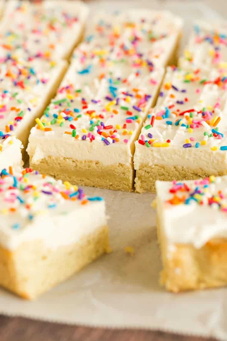 A pan of sugar cookie bars sliced into squares.