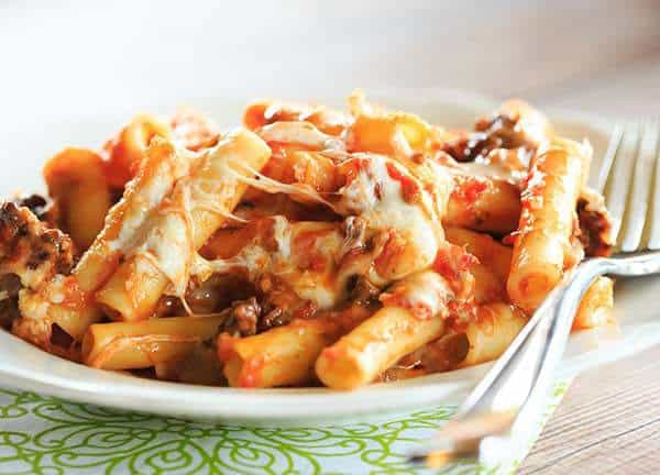 Cheesy Baked Ziti with Sausage - this will become a staple at your family dinners. The perfect baked pasta dish! | https://www.browneyedbaker.com/baked-pasta/