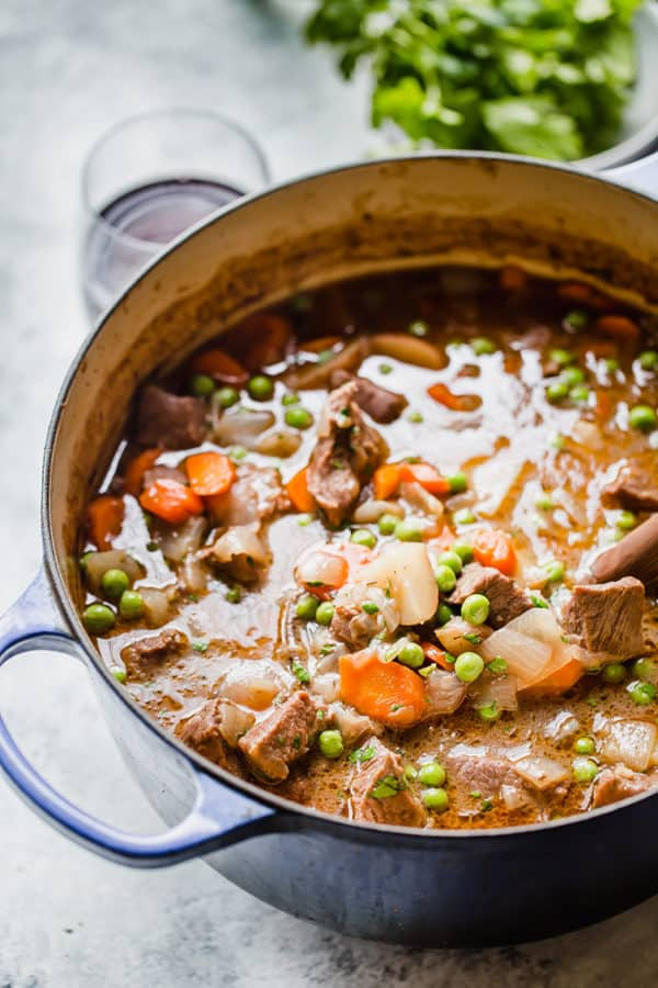 A Dutch oven filled with beef stew.