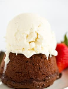 Gooey Chocolate Cakes - Baked in individual servings and packed with loads of chocolate flavor, this recipe from Dorie Greenspan is perfect for dinner parties or keeping some dessert stashed in the freezer!