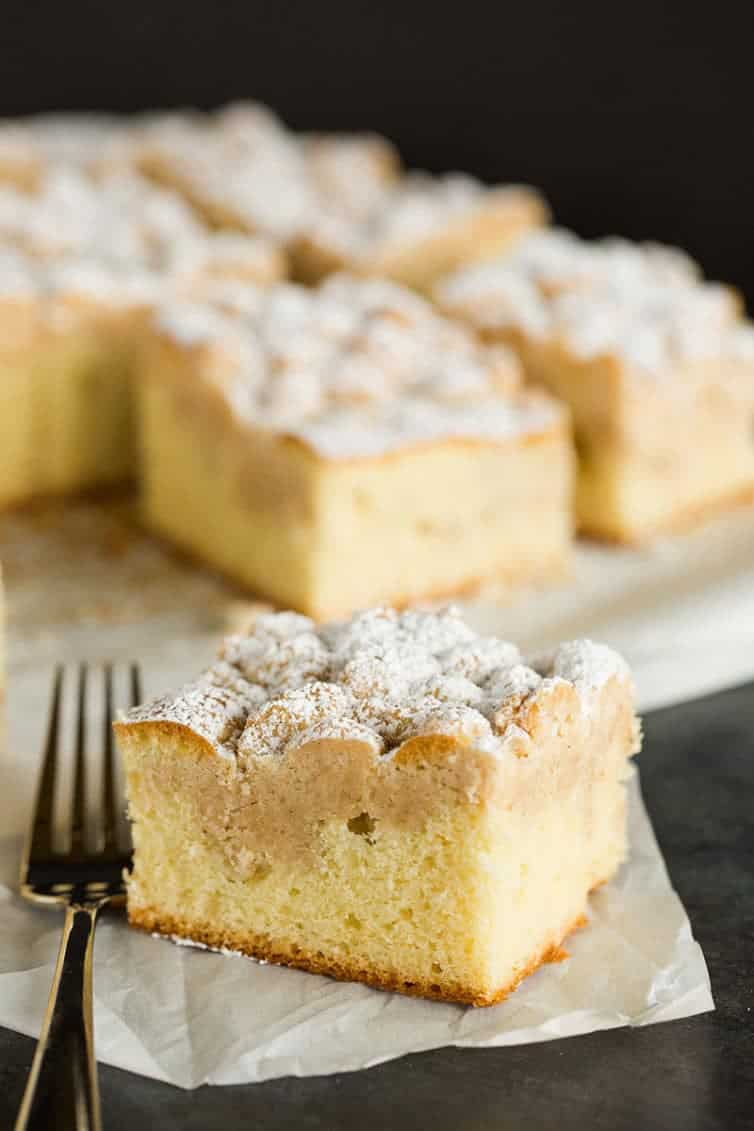 A slice of crumb cake with a fork.