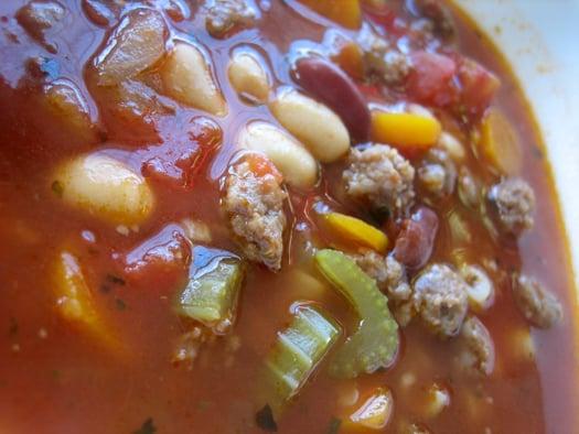 Close up image of pasta fagioli soup.