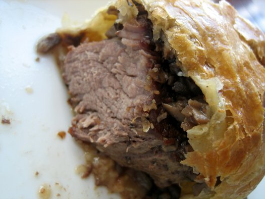 Showing the inside texture of beef Wellington.