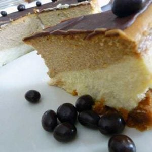 Slice of coffee and espresso layered cheesecake on a white plate.