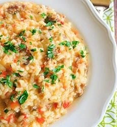 Sausage, Pepper & Mushroom Risotto - A hearty meal that needs only Italian bread and a big salad as an accompaniment! | https://www.browneyedbaker.com/italian-sausage-red-pepper-and-mushroom-risotto/