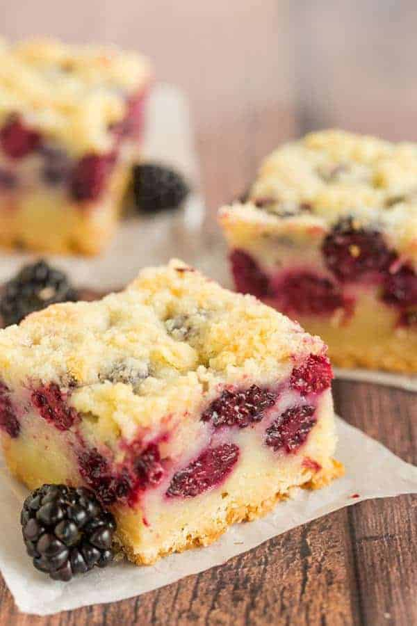 Three blackberry pie bars cut into squares.