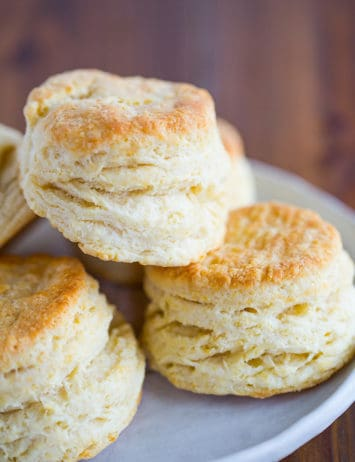 A plate of buttermilk biscuits stacked together.