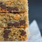 A big stack of chewy, chunky blondies with chocolate chips, butterscotch chips, walnuts and coconut.
