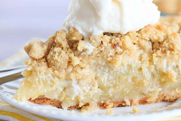 Dutch Apple Pie - A perfect crust piled high with the best apple filling and topped with a crunchy crumb. The perfect fall dessert! | browneyedbaker.com