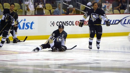 Sid stretching during pre-game warmups