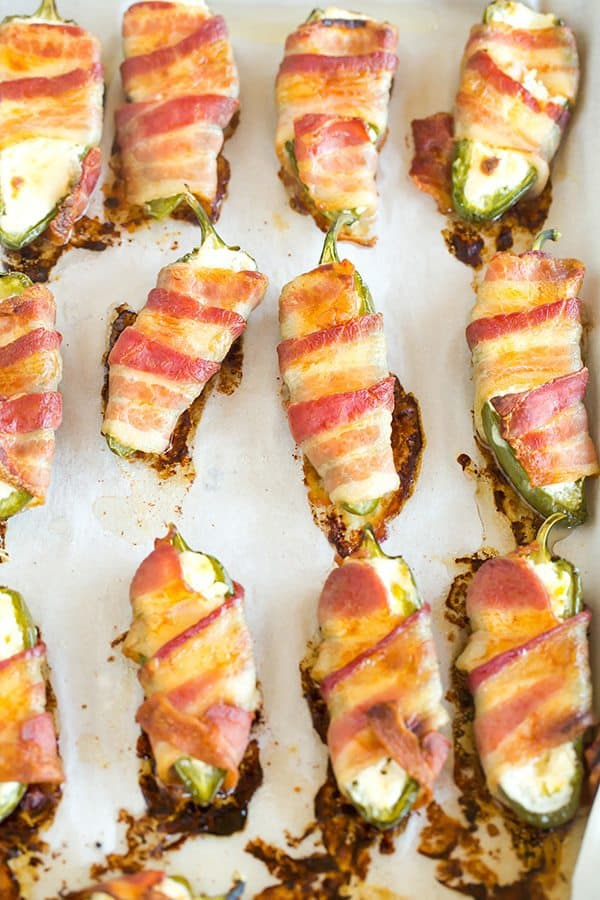 Jalapeno Poppers - A classic! Just three ingredients and super easy - halved, seeded jalapeños are stuffed with cream cheese and wrapped with bacon.