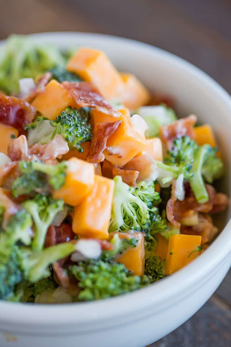 A bowl of broccoli salad with bacon and cheese.