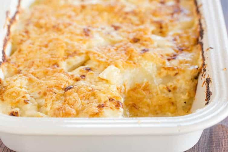 Scalloped Potatoes - A classic dish and holiday staple! This easy homemade recipe comes together quickly and is wonderfully rich and cheesy.