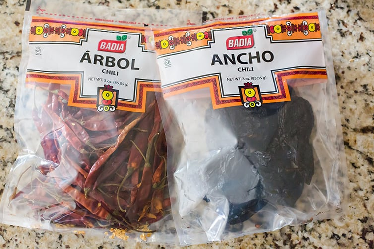 Bags of dried ancho and dried arbol chiles.